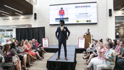 A photo of a student posing in their suit during the 2019 Dress for Success event.
