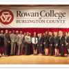 Dress for Success students in front of RCBC logo