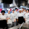 Culinary students standing side-by-side in RCBC culinary kitchen