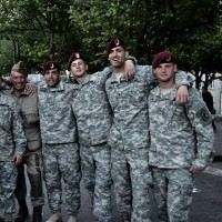 Joshua Redlich standing with his Army colleagues