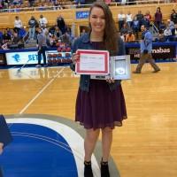 Susan Glade with award