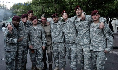 Joshua Redlich standing among his Army colleagues