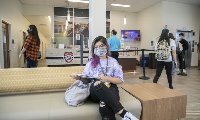 female student sitting in Student Success Center lounge