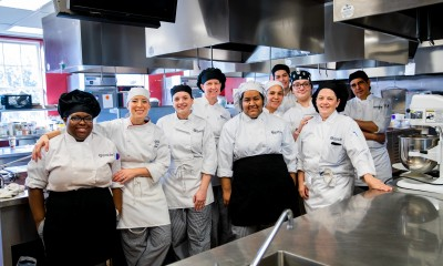 culinary students standing side-by-side in RCBC kitchen