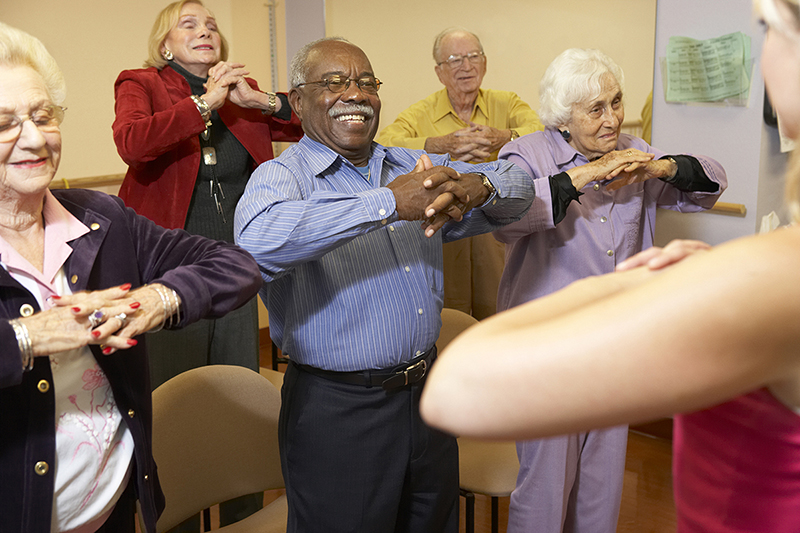 Older people doing balance exercises