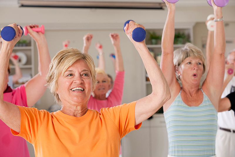 older women exercising with small hand weights
