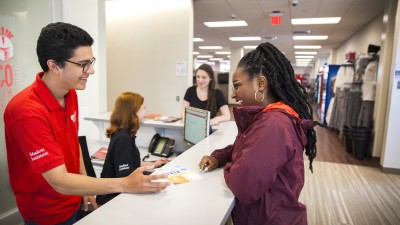 Student getting assistance at the student help desk